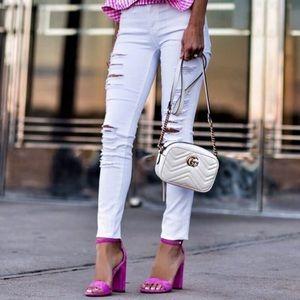 Frame white ripped skinny jeans